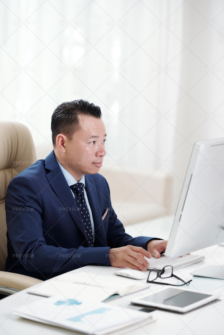 Businessman Working At The Table At: Stock Photos
