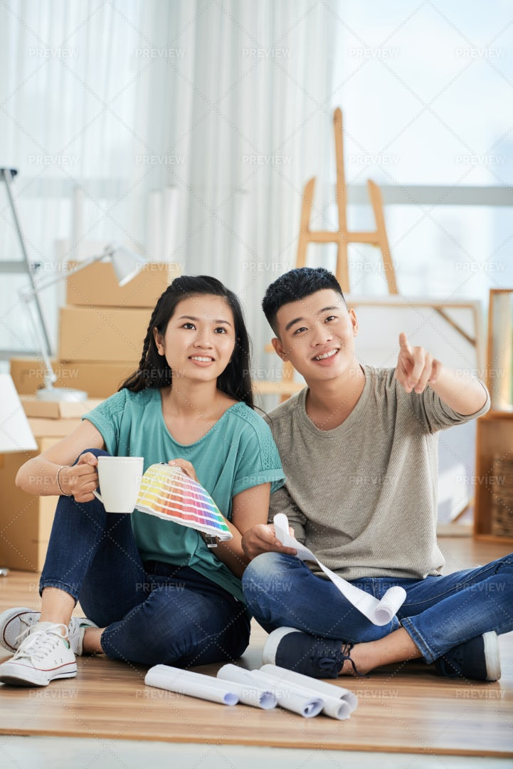 Couple Thinking Over Repair In The: Stock Photos