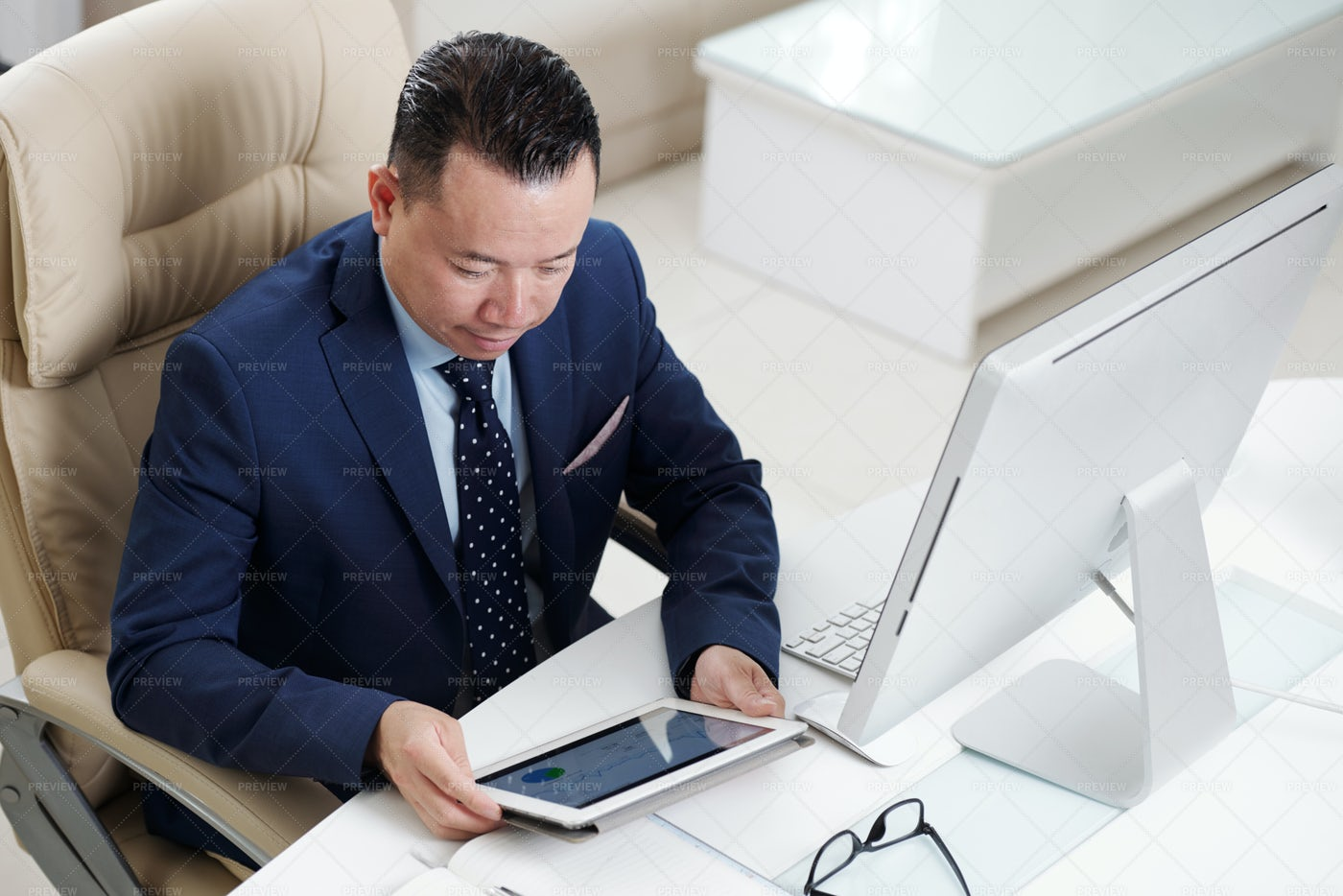 Businessman Working Online At Tablet Pc: Stock Photos