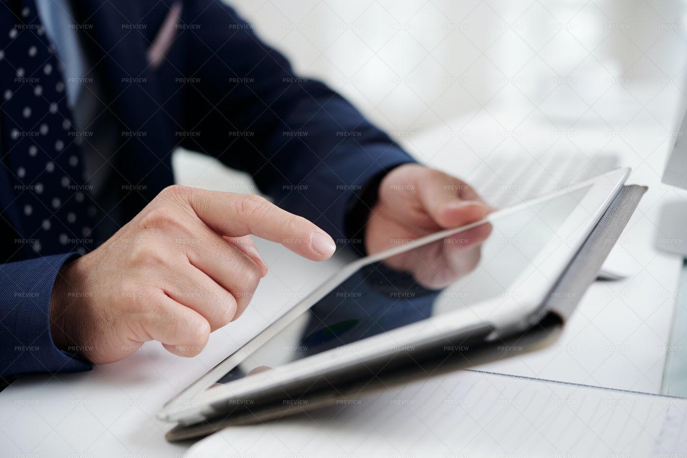 Man Working On Digital Tablet: Stock Photos