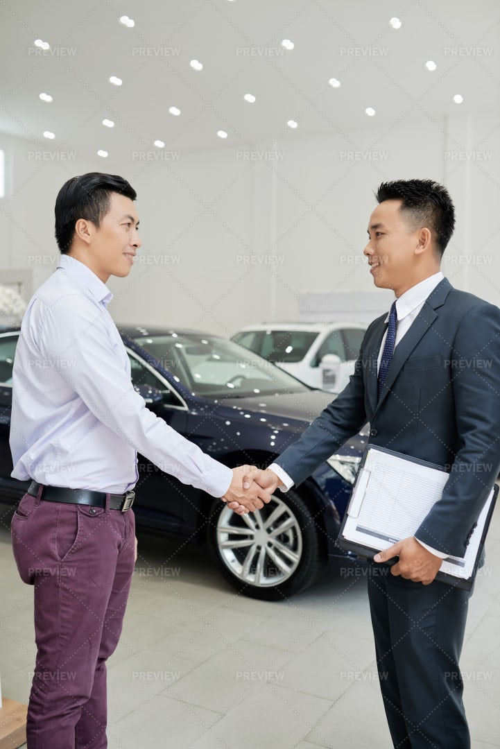 Meeting With Car Dealership Worker: Stock Photos