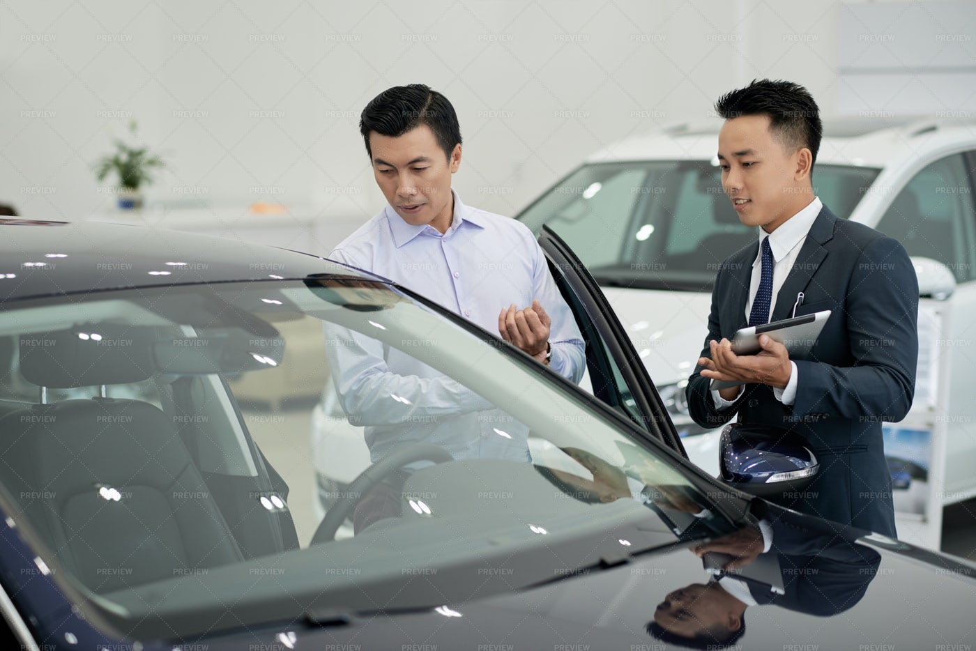 Dealership Working Taking To Client: Stock Photos
