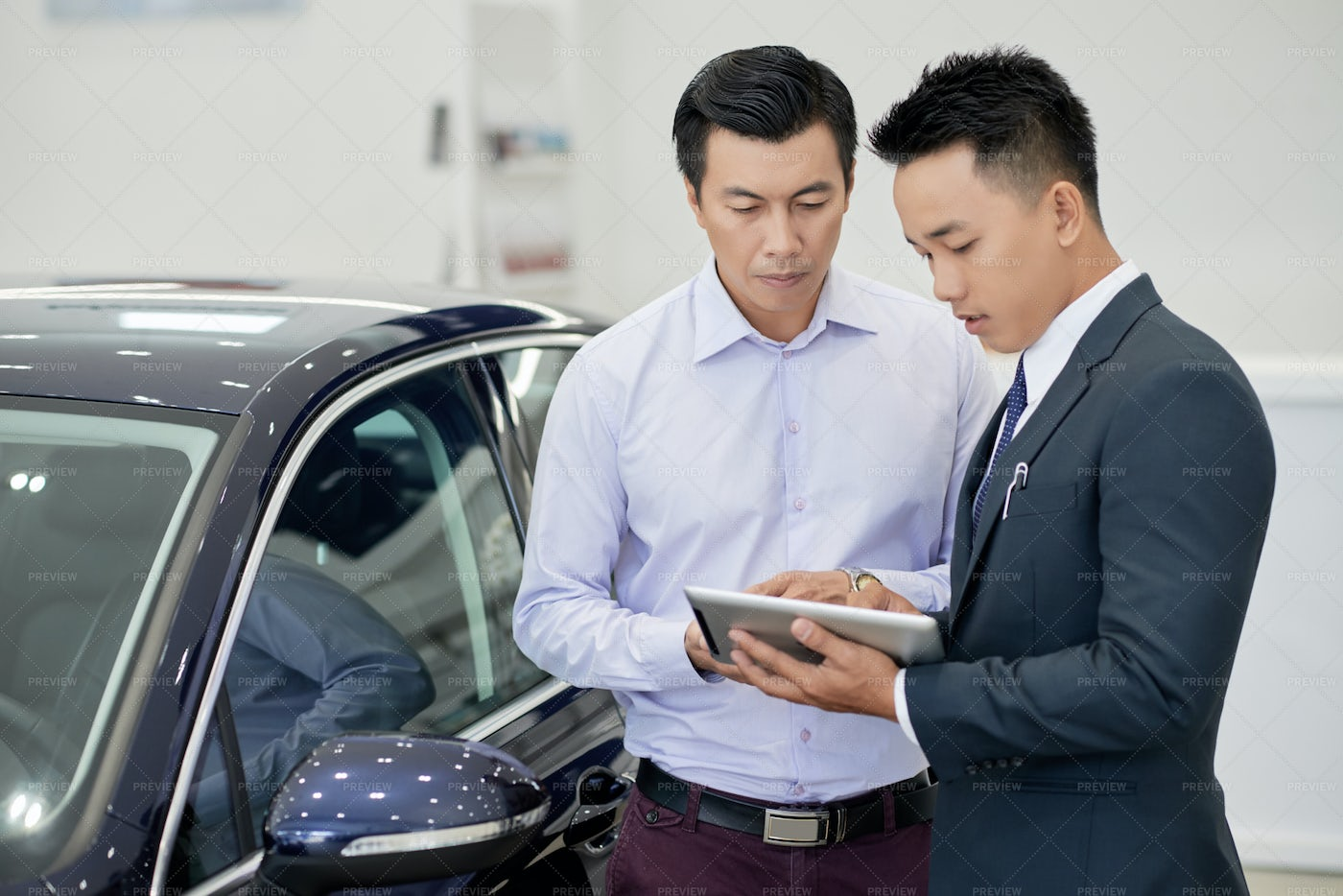 Car Dealership Manager Working With: Stock Photos