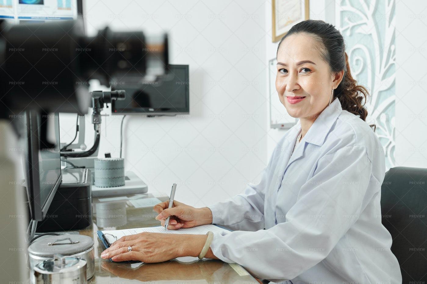 Female Optometrist At Office: Stock Photos