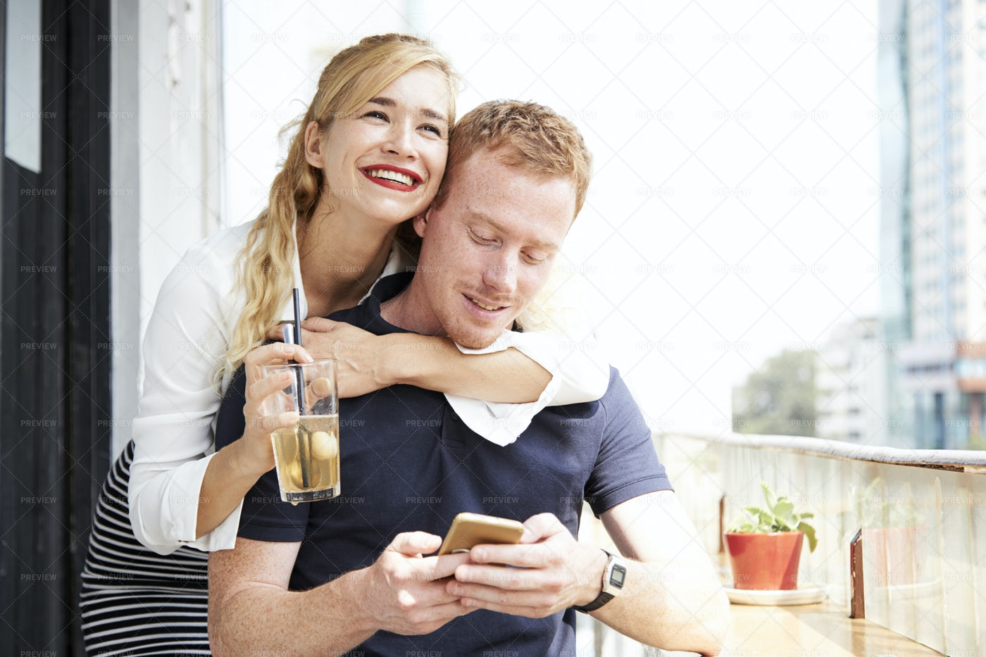 Cheerful Young Couple In Cafe: Stock Photos