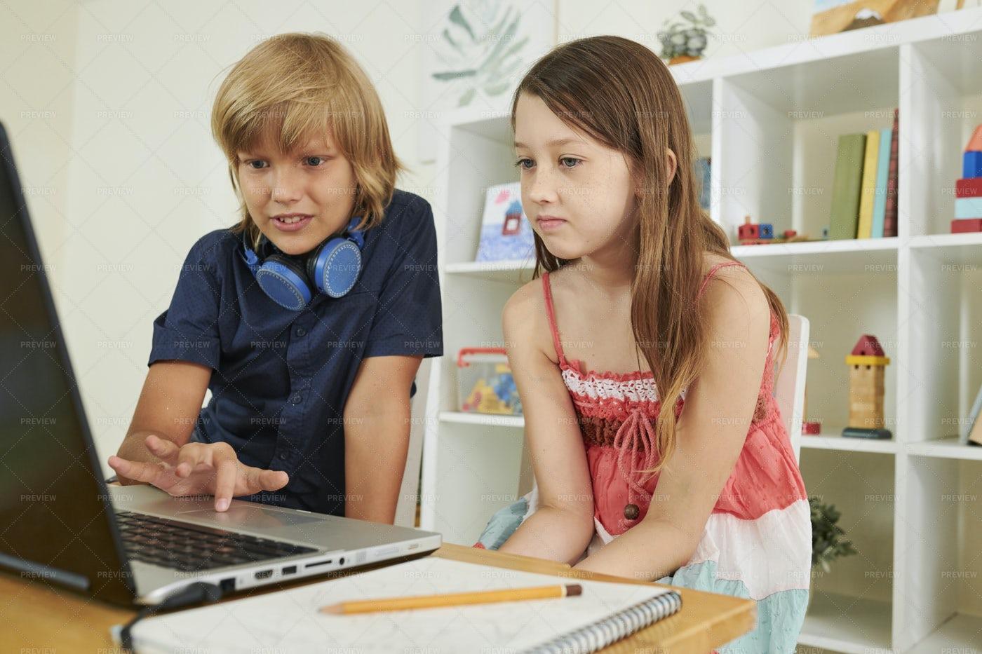 Preteen Boy Helping Classmate: Stock Photos