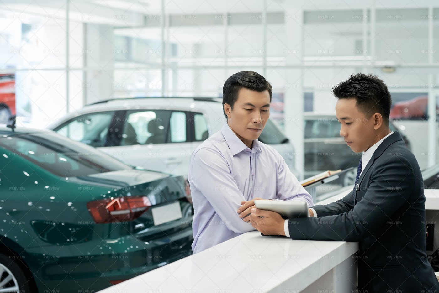 Sales Manager Showing Contract Details: Stock Photos