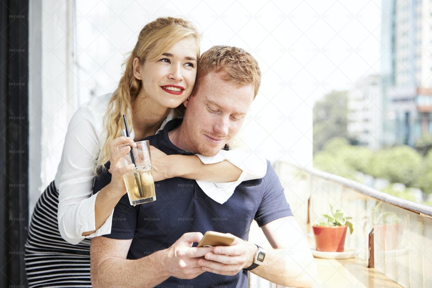 Cheerful Woman Hugging Boyfriend: Stock Photos