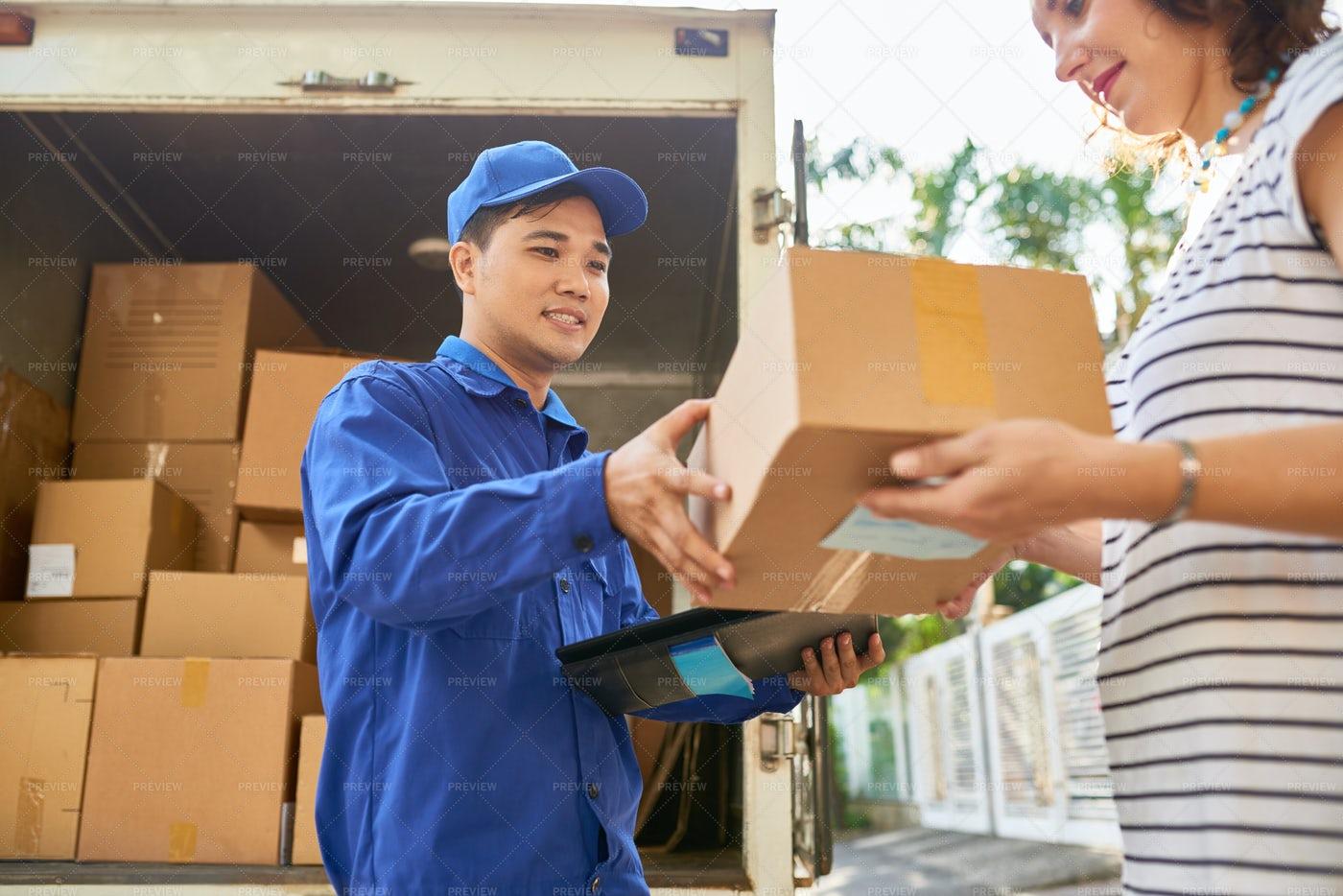 Courier Delivering Parcel: Stock Photos