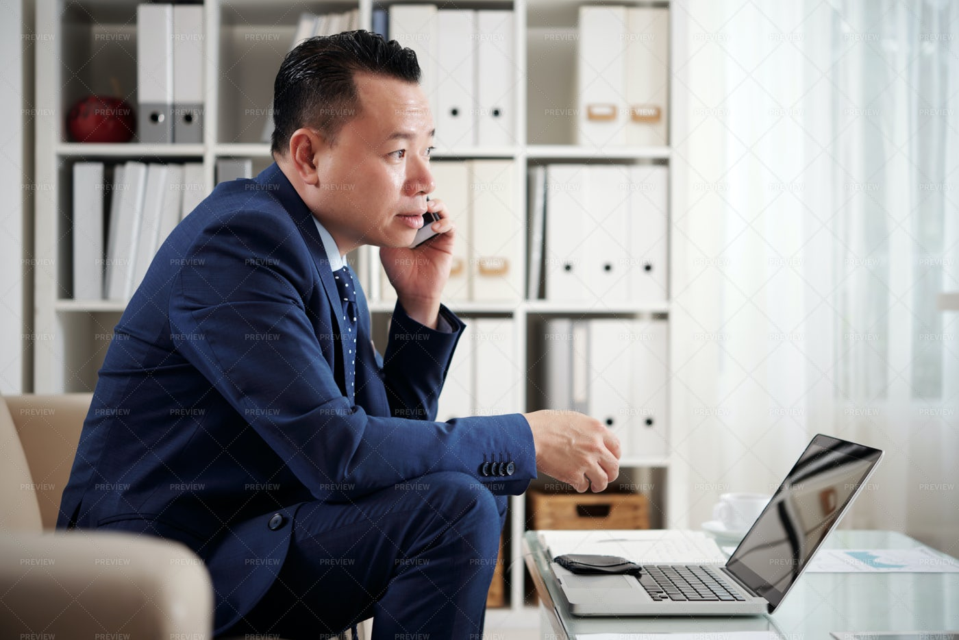 Businessman Talking On The Phone At: Stock Photos