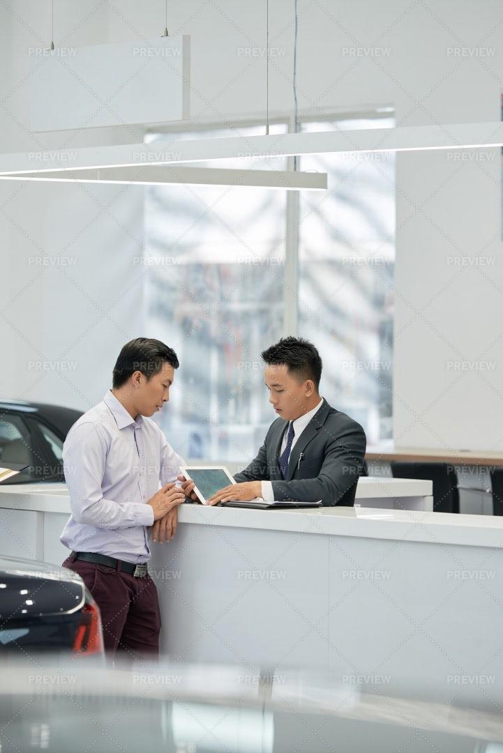 Salesman And Customer Reading Leasing: Stock Photos
