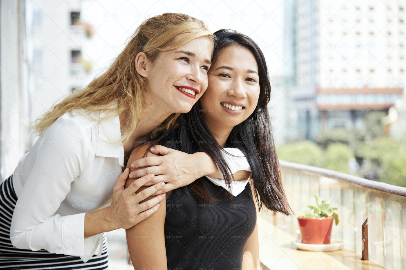 Young Woman Hugging Her Best Friend: Stock Photos
