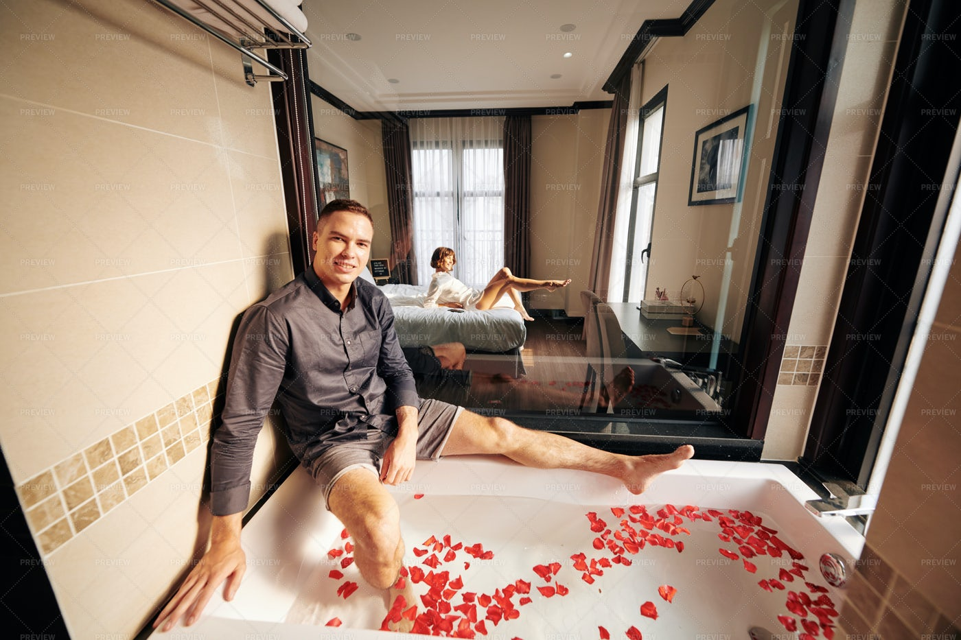 Man Preparing Bath For Him And His: Stock Photos