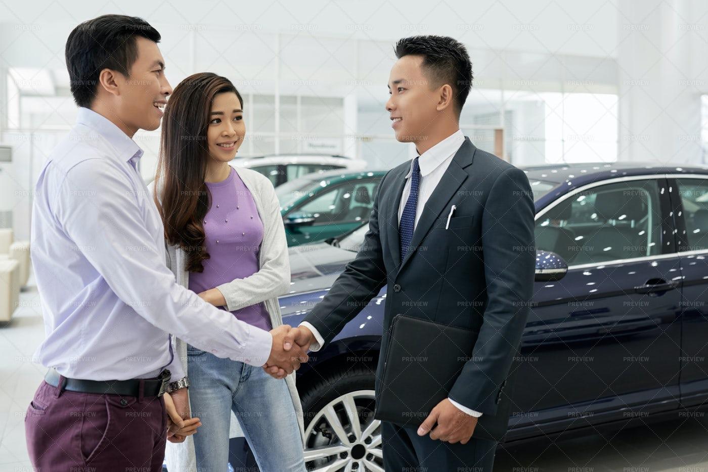 Couple Visiting Car Dealership: Stock Photos