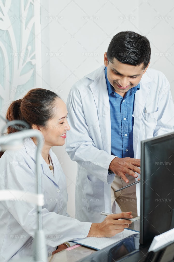 Two Doctors Discussing In Team: Stock Photos