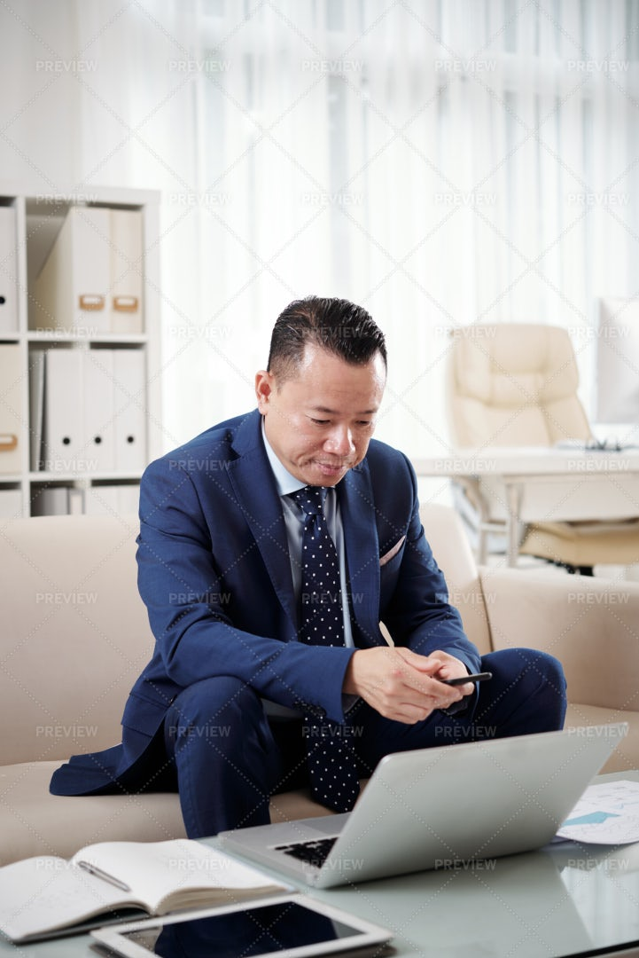 Businessman Working On Laptop At Office: Stock Photos
