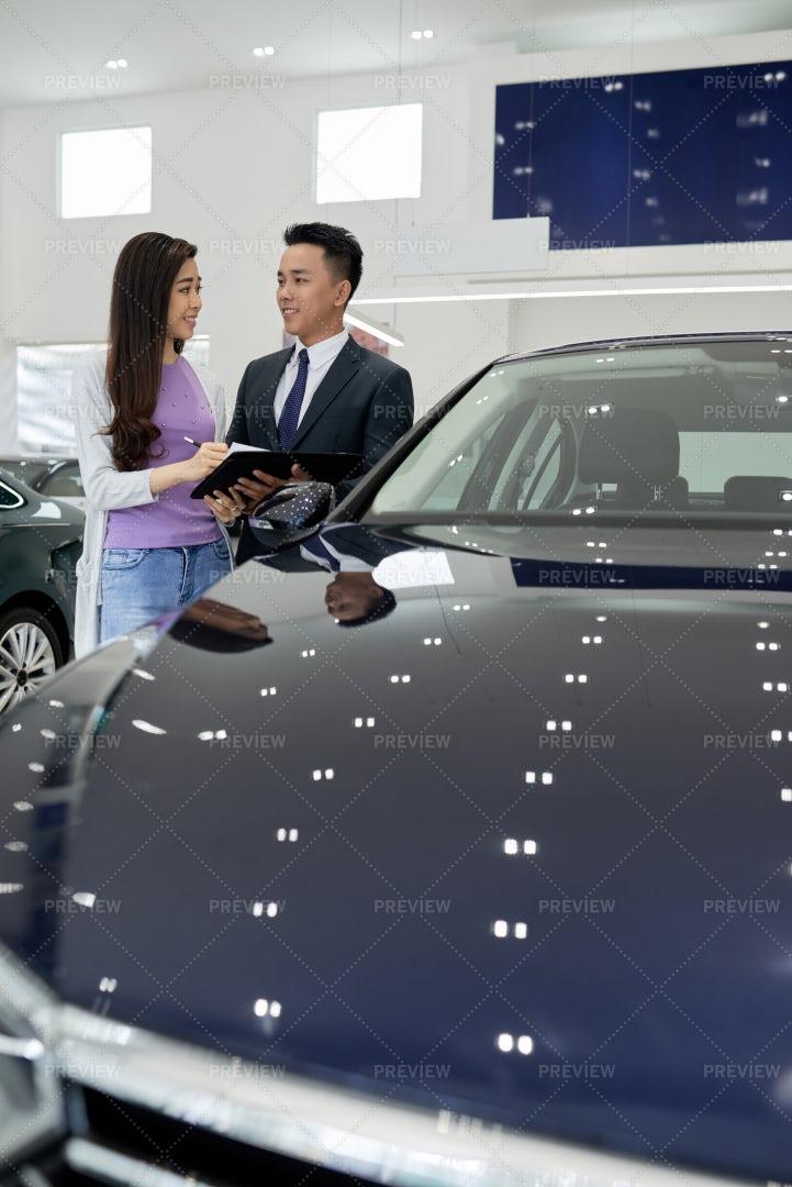 Vietnamese Woman Buying Car: Stock Photos
