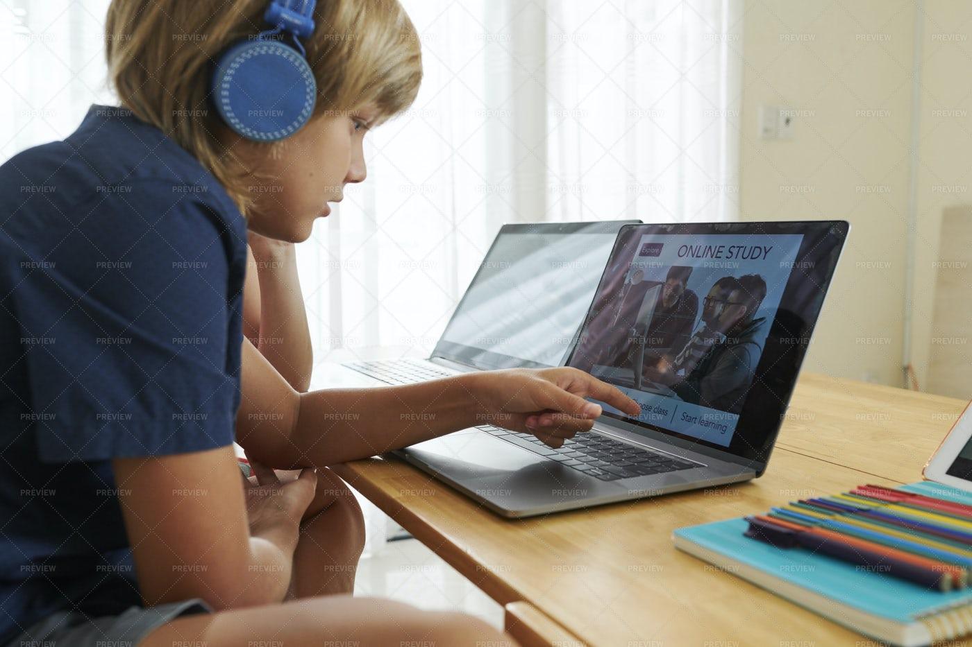 School Children Watching Class Online: Stock Photos