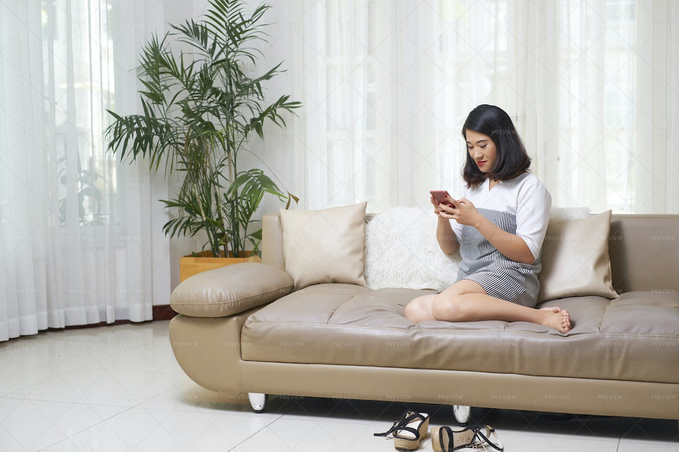 Woman Using Smartphone At Home: Stock Photos