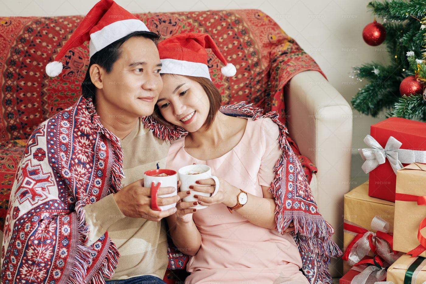 Vietnamese Couple Relaxing At Home: Stock Photos
