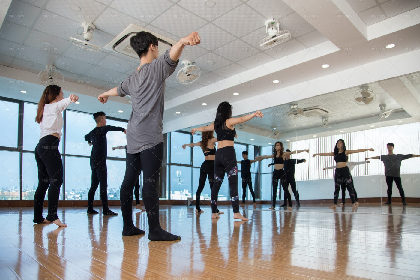 Group Of Dancers Repeating After Front: Stock Photos