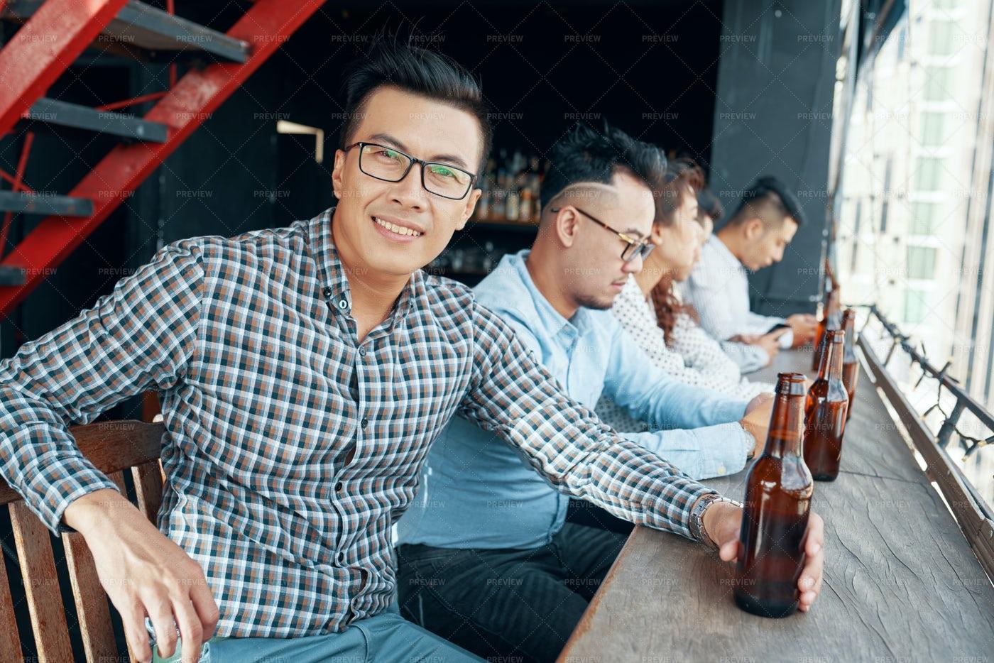Businessman Drinking Beer At Bar: Stock Photos