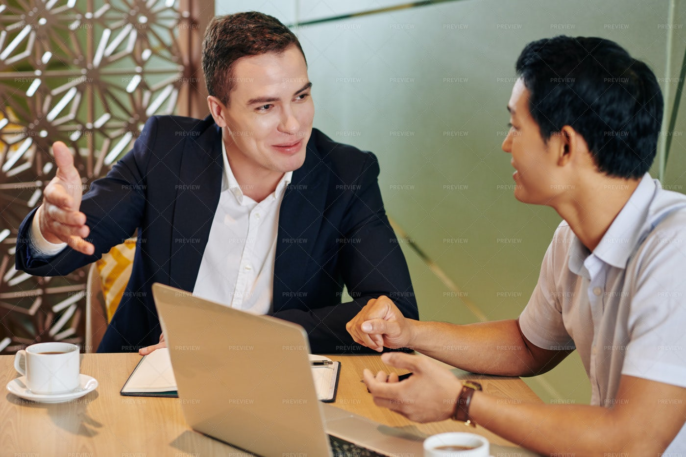 Businessman Talking To Coworker: Stock Photos