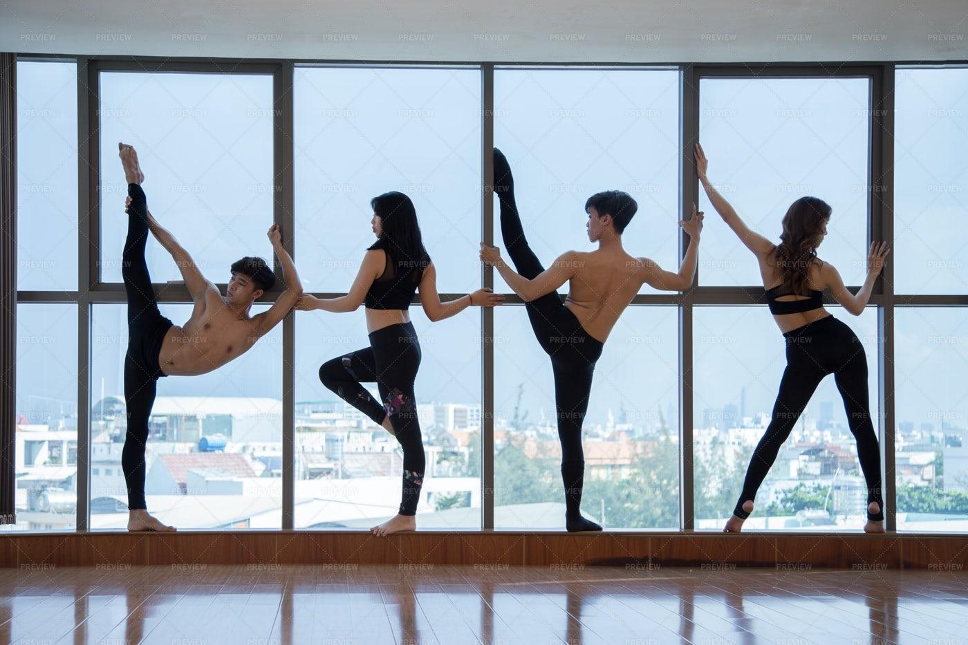 Dancers Stretching At Big Window: Stock Photos