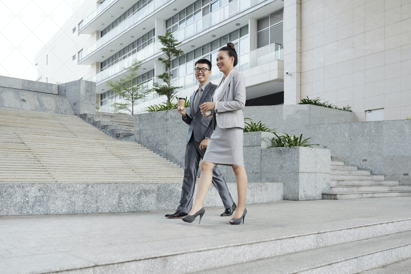 Business Couple Walking In The City: Stock Photos