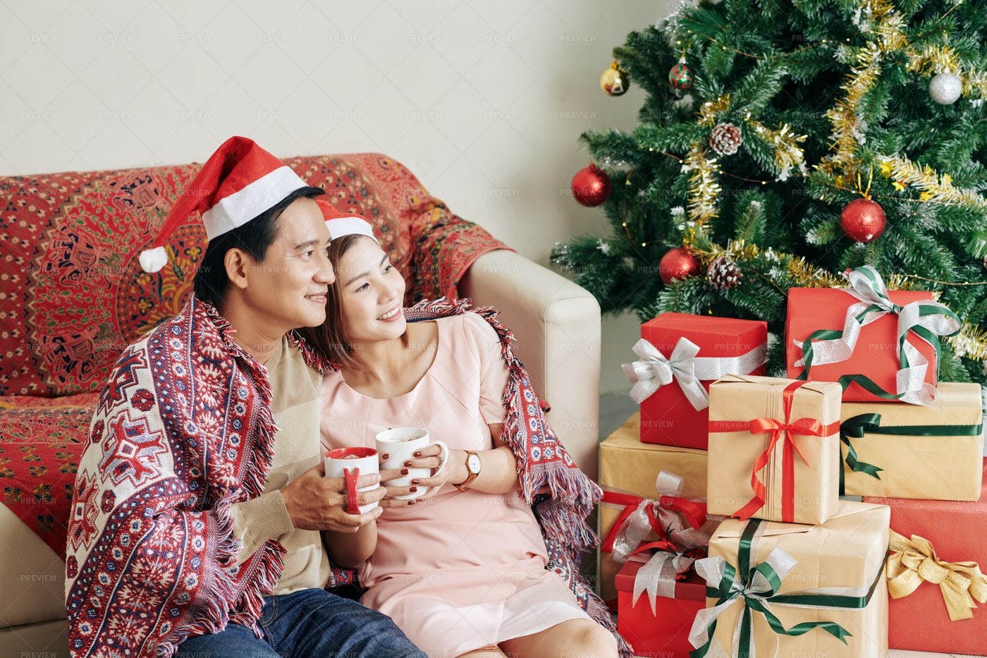 Happy Couple Enjoying Christmas Morning: Stock Photos