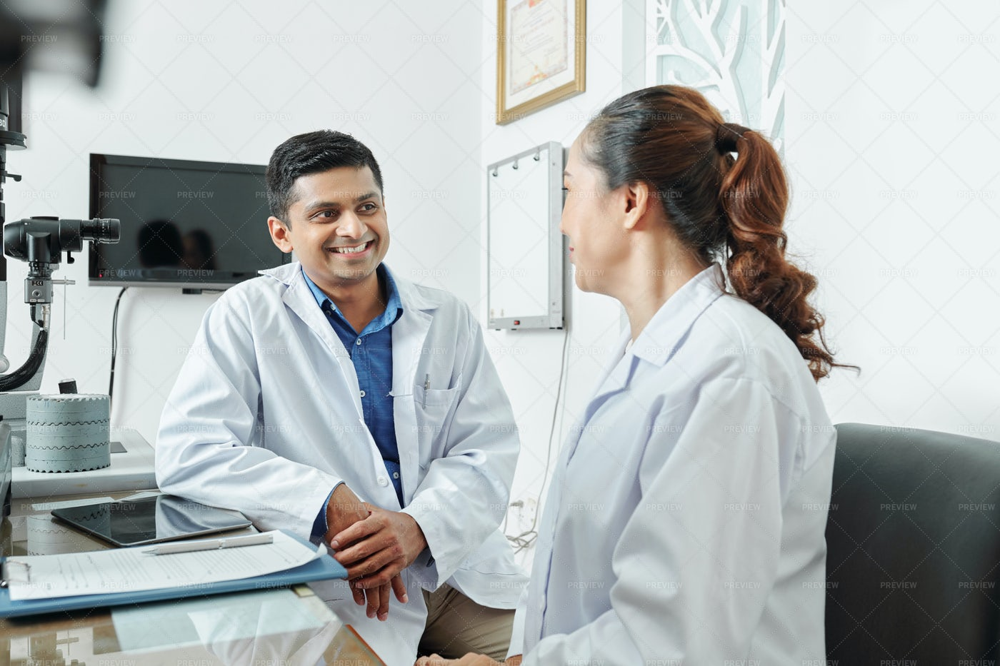 Two Doctors Talking At Office: Stock Photos