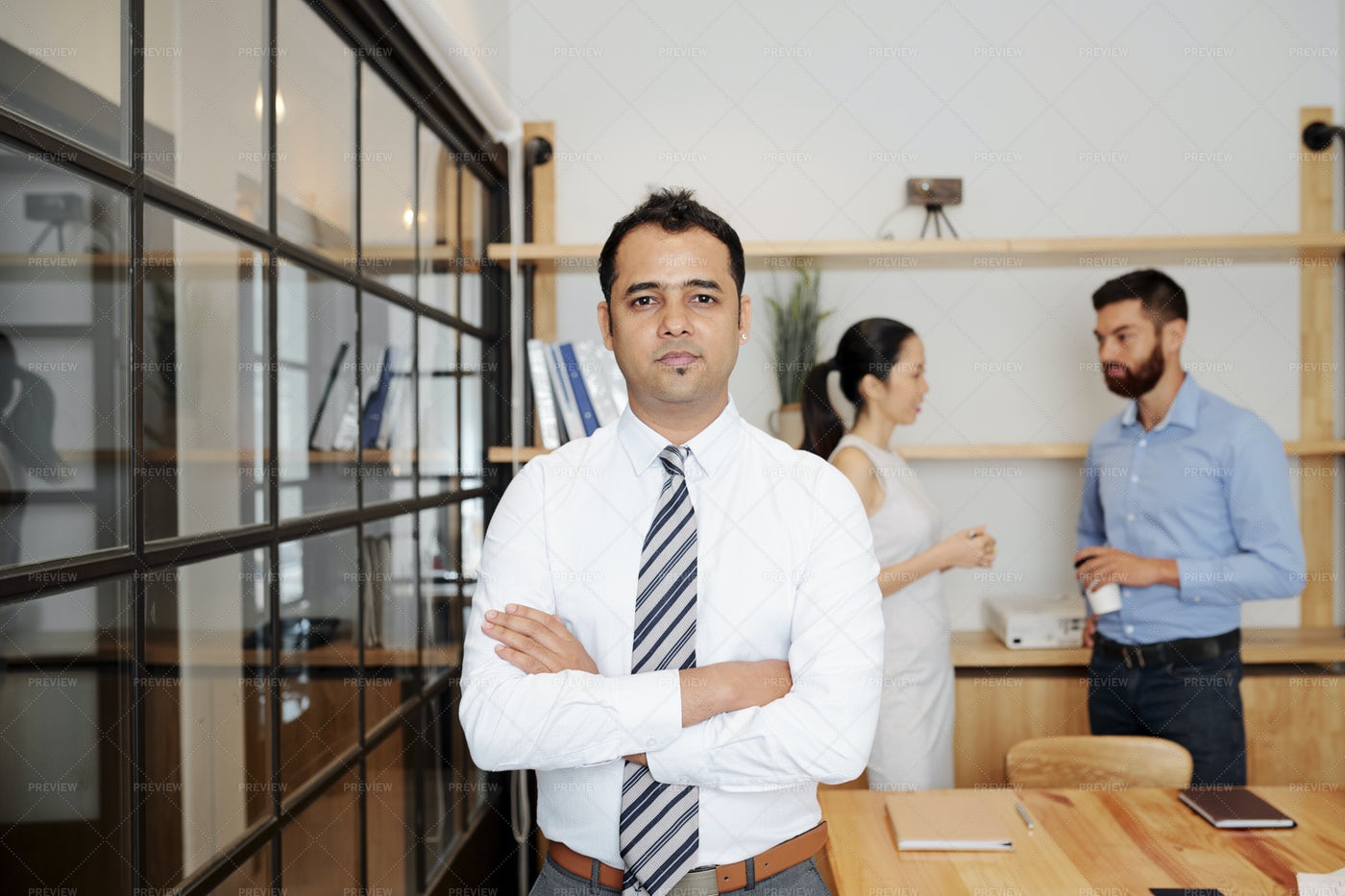 Indian Male Leader Standing At Office: Stock Photos
