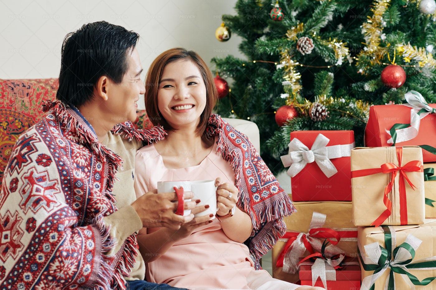 Happy Couple On Christmas Morning: Stock Photos