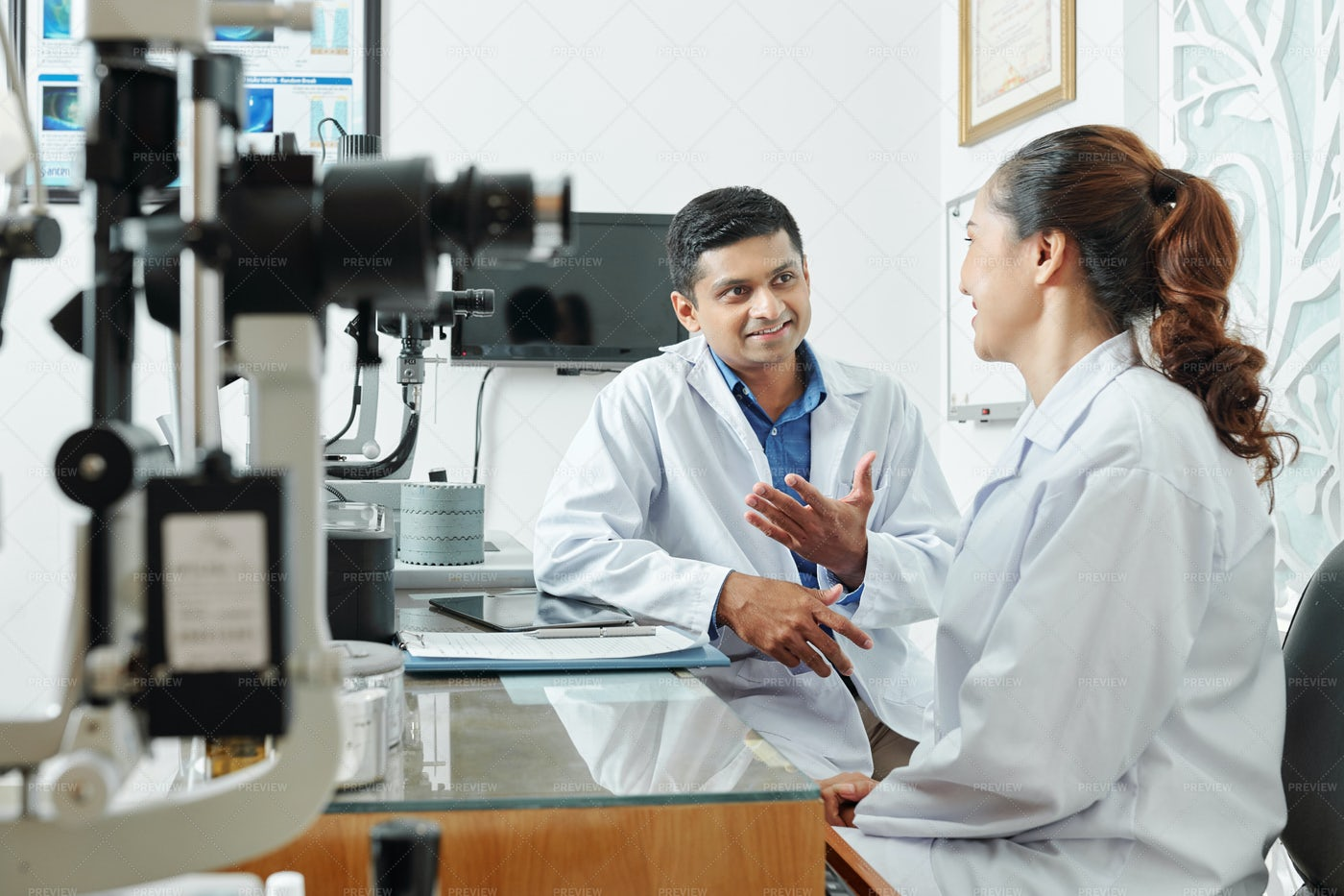 Two Optometrists Working In Team: Stock Photos