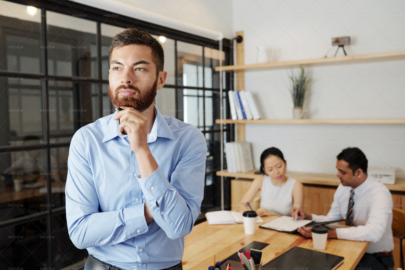 Pensive Businessman Standing At Office: Stock Photos