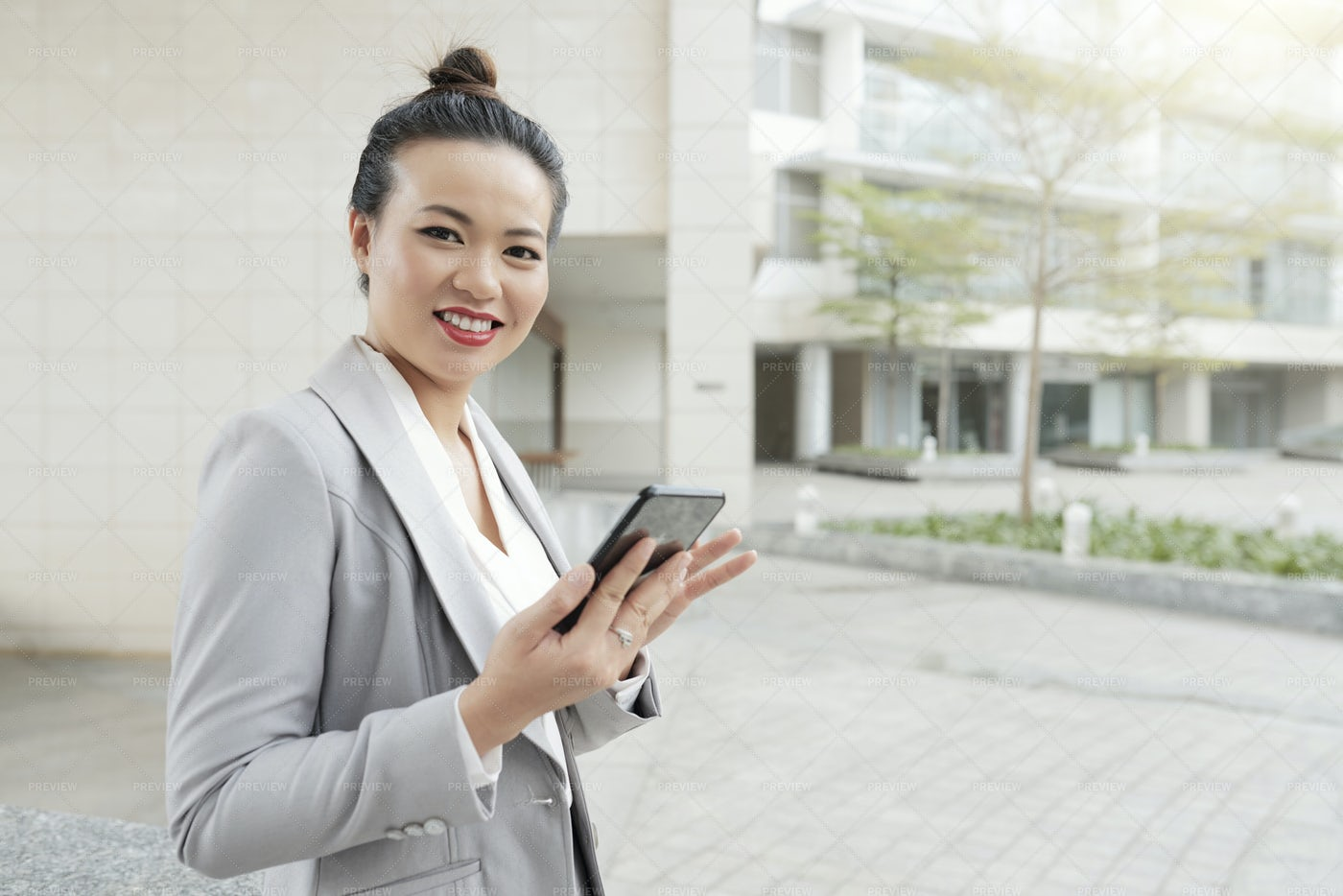 Businesswoman With Mobile Phone In The: Stock Photos