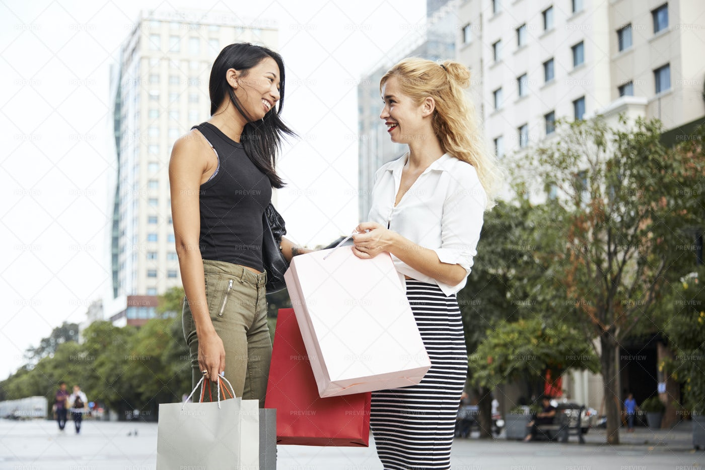 Gossiping Young Women: Stock Photos