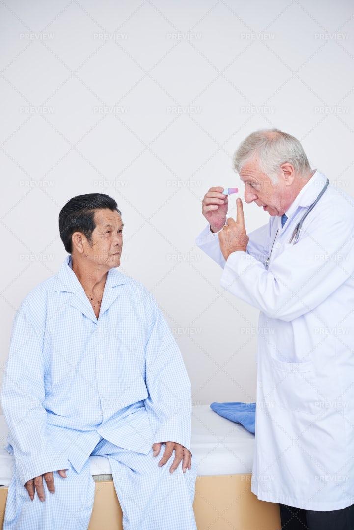 Ophthalmologist Talking To Senior: Stock Photos