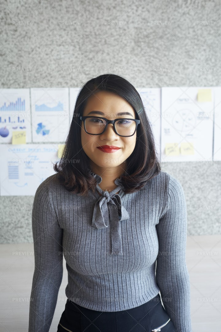 Young Female Office Worker At Office: Stock Photos