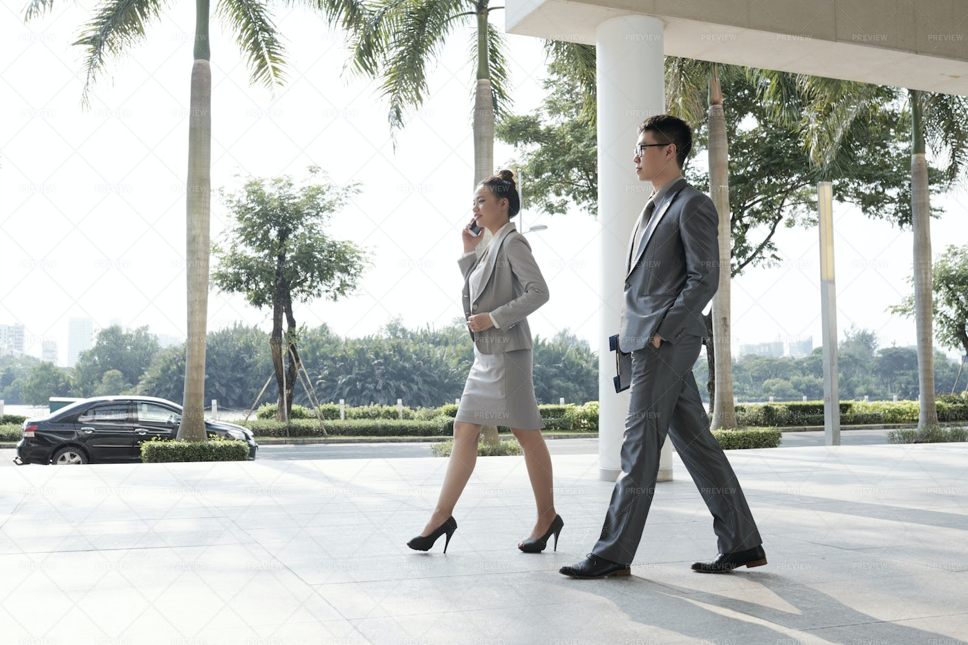 Business People Walking In The City: Stock Photos