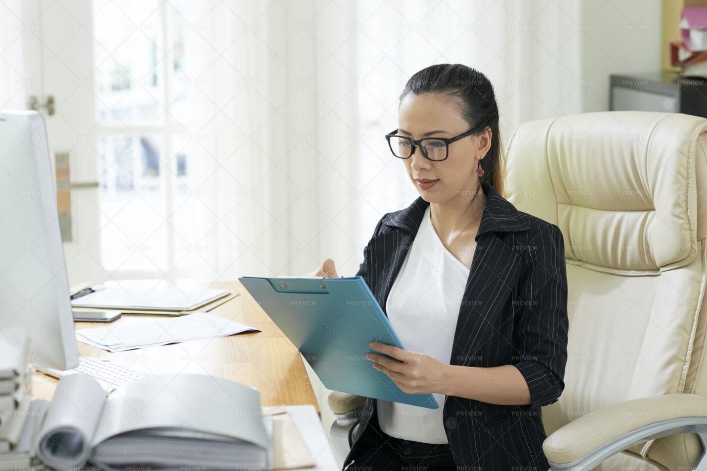 Businesswoman Checking Data: Stock Photos