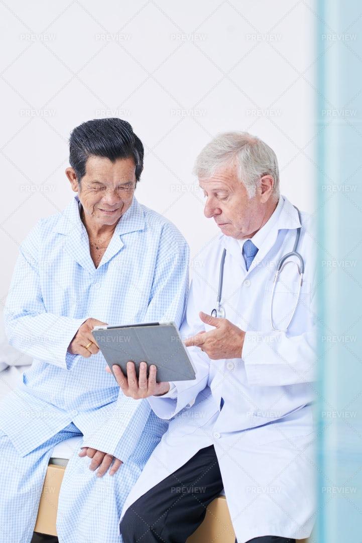 Doctor Showing Prescription To Senior: Stock Photos