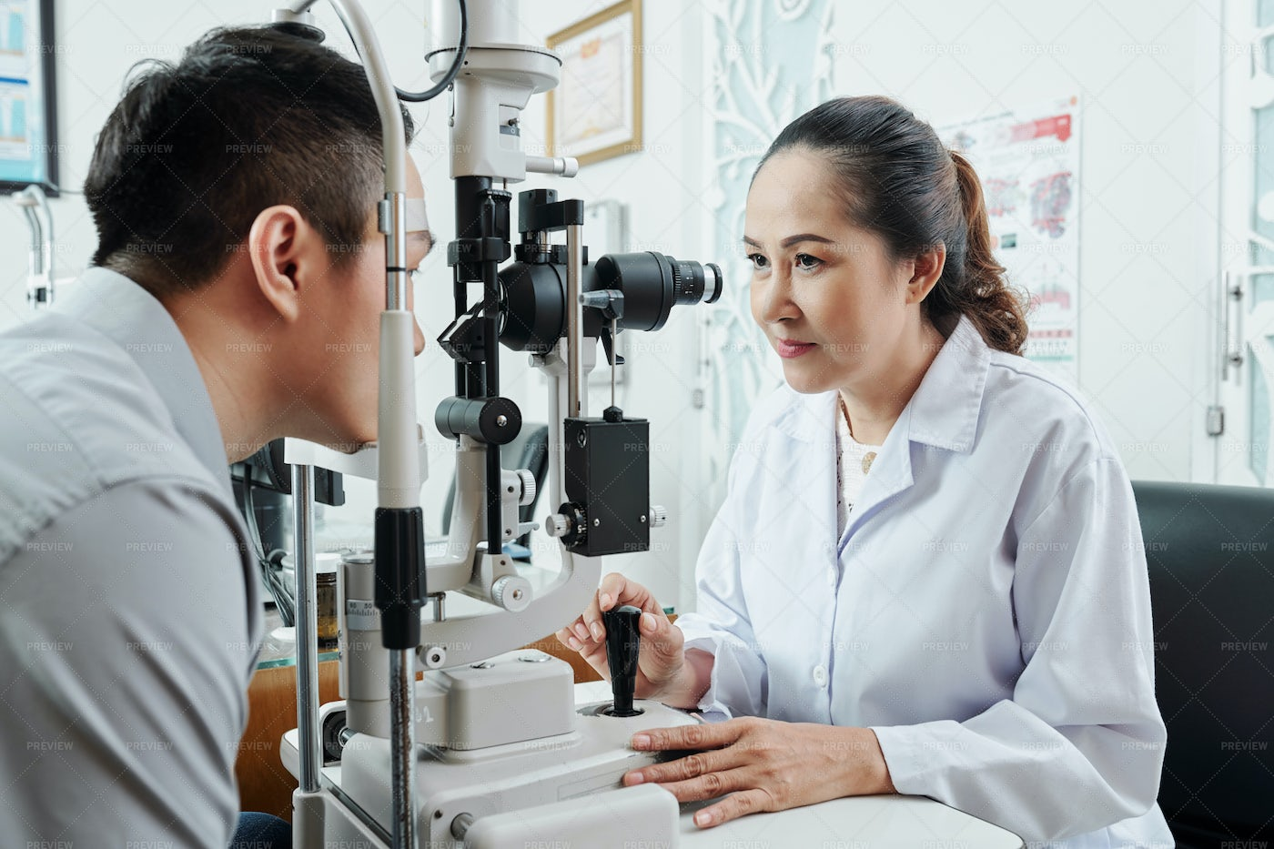 Asian Optometrist Working At Office: Stock Photos