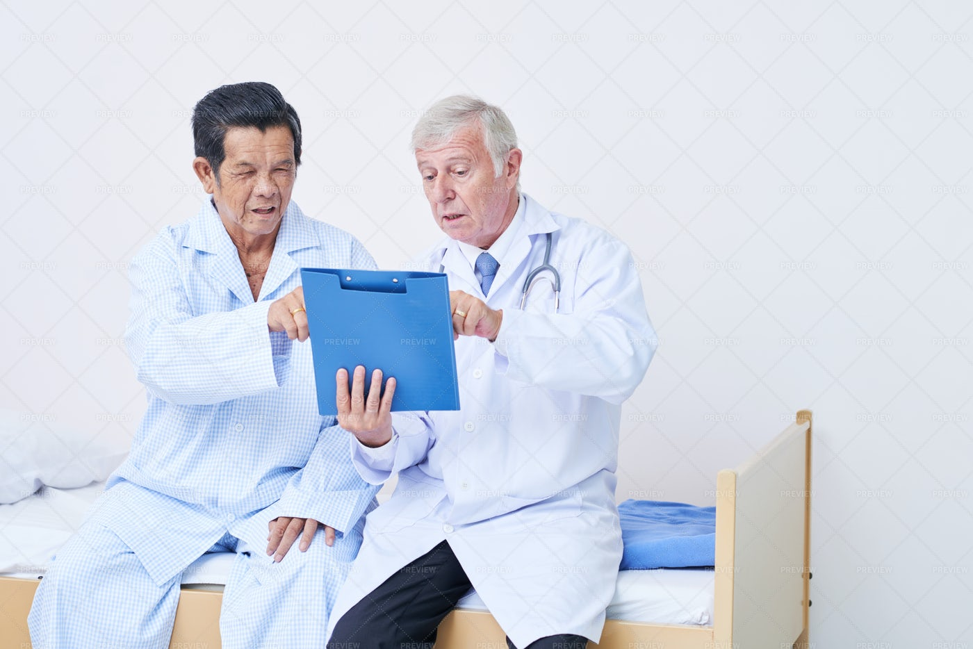 Doctor And Senior Patient Discussing: Stock Photos
