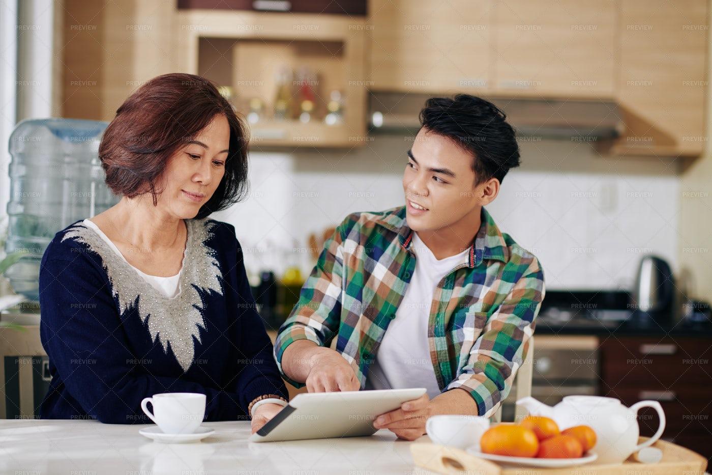 Man Visiting Mother At Home: Stock Photos