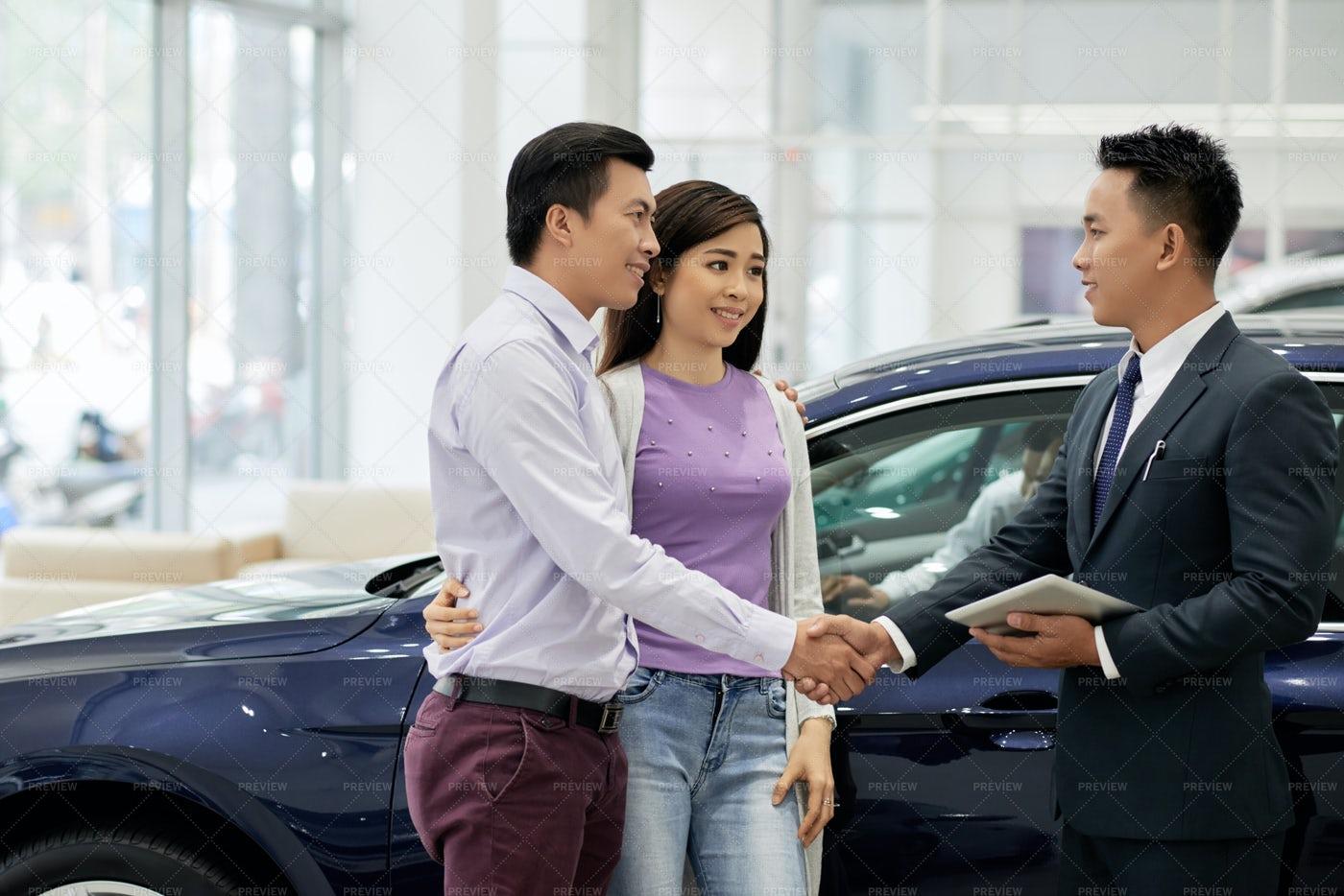 Husband And Wife Buying Car: Stock Photos