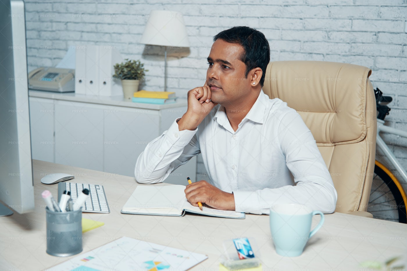 Businessman Thinking Over New Project: Stock Photos
