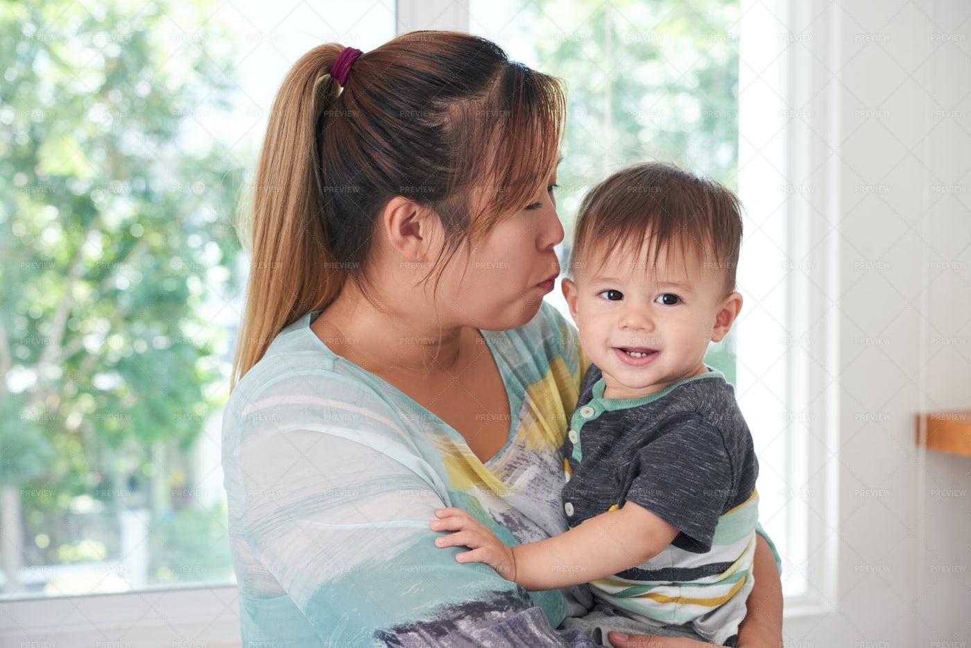Mother Kissing Son: Stock Photos