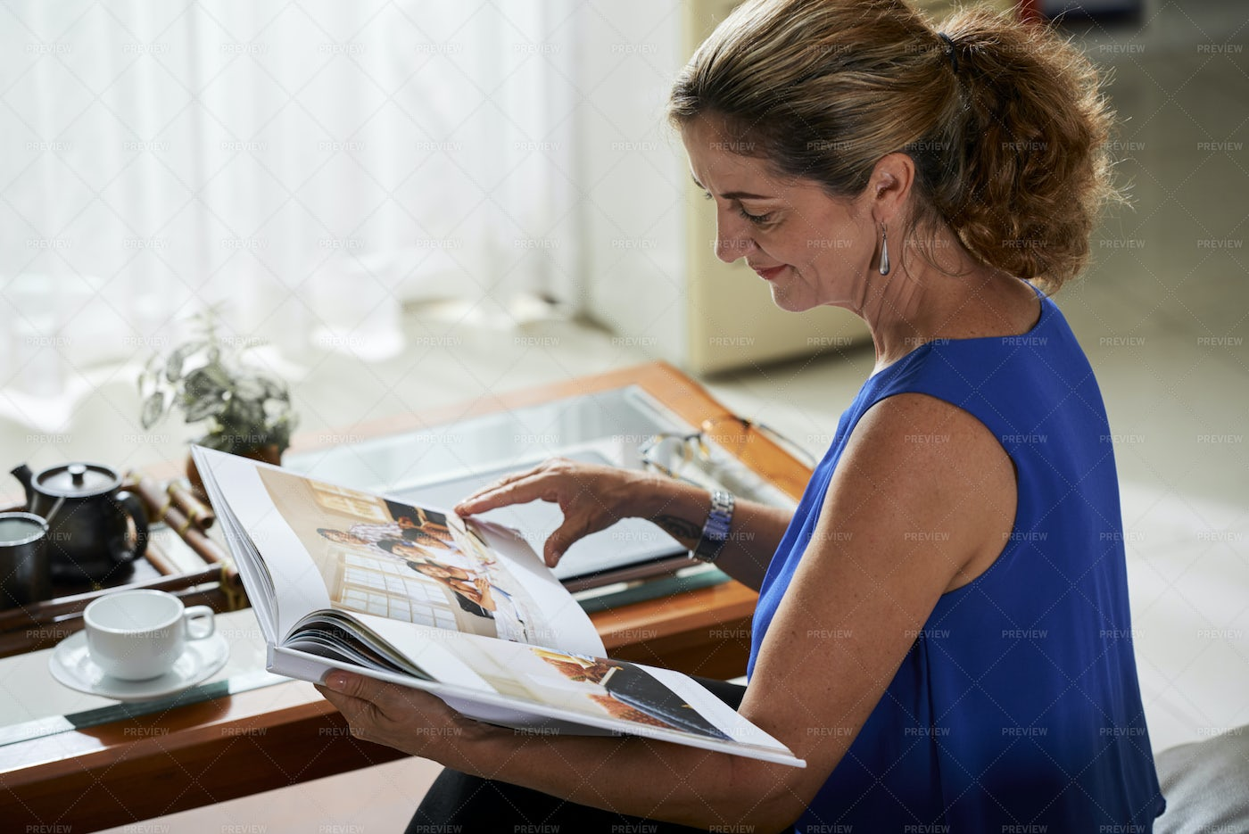Woman With Photo Album At Home: Stock Photos