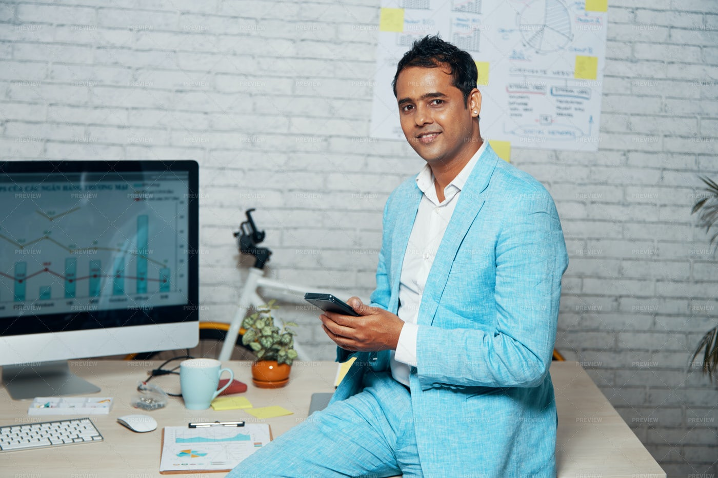 Businessman Using Mobile Phone In His: Stock Photos
